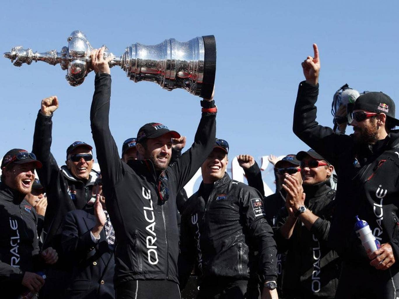 Ben Ainslie collects the mammoth Americas Cup trophy