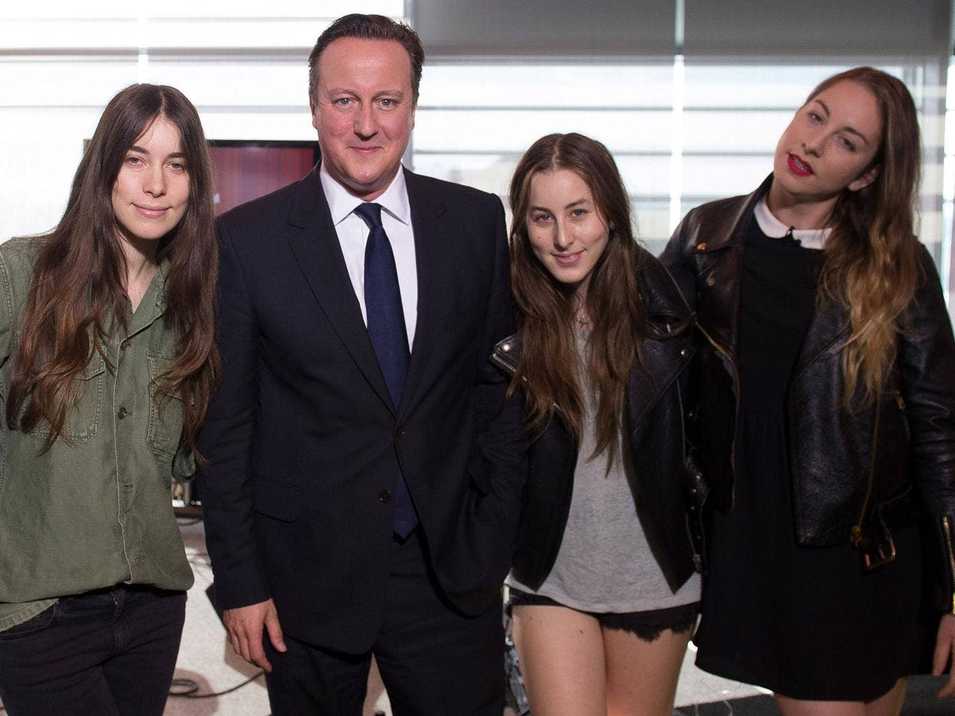 Prime Minister David Cameron poses the rock group Haim as they appear on the BBC current affairs programme, The Andrew Marr Show
