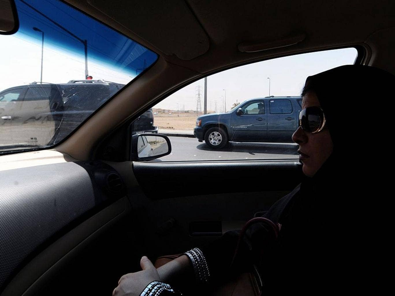 A Saudi woman sits in a car in Riyadh: After activists called for a day of defiance against women driving ban, a senior cleric says it damages their ovaries and unborn children