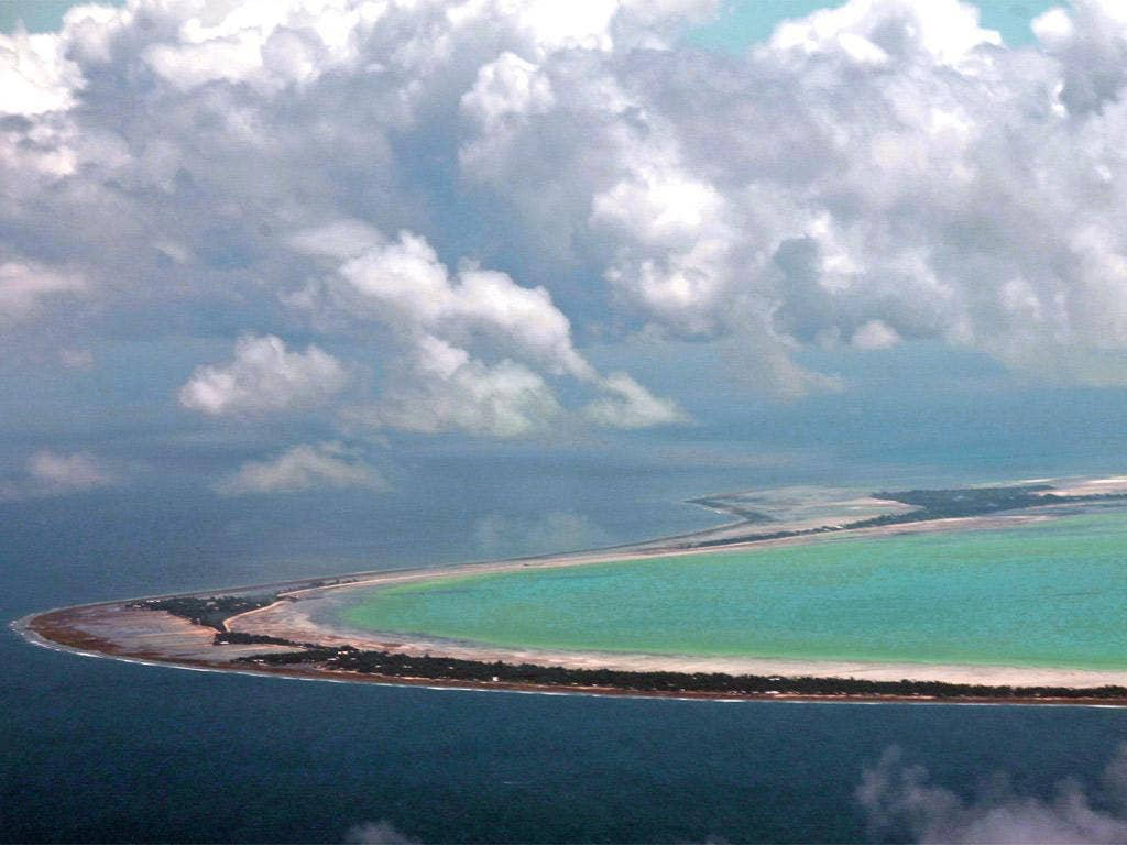 Kiribati, a low-lying island nation in the central Pacific, would disappear if sea levels rise by just one metre