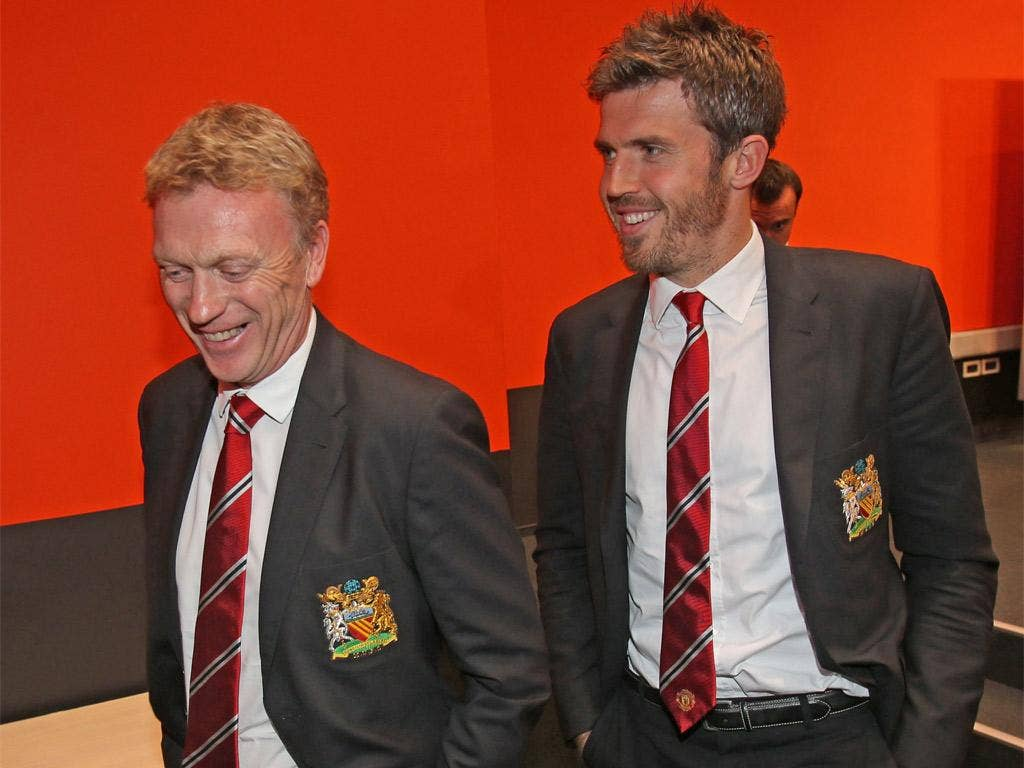 The United manager, David Moyes, arrives with midfielder Michael Carrick for his press conference in Donetsk