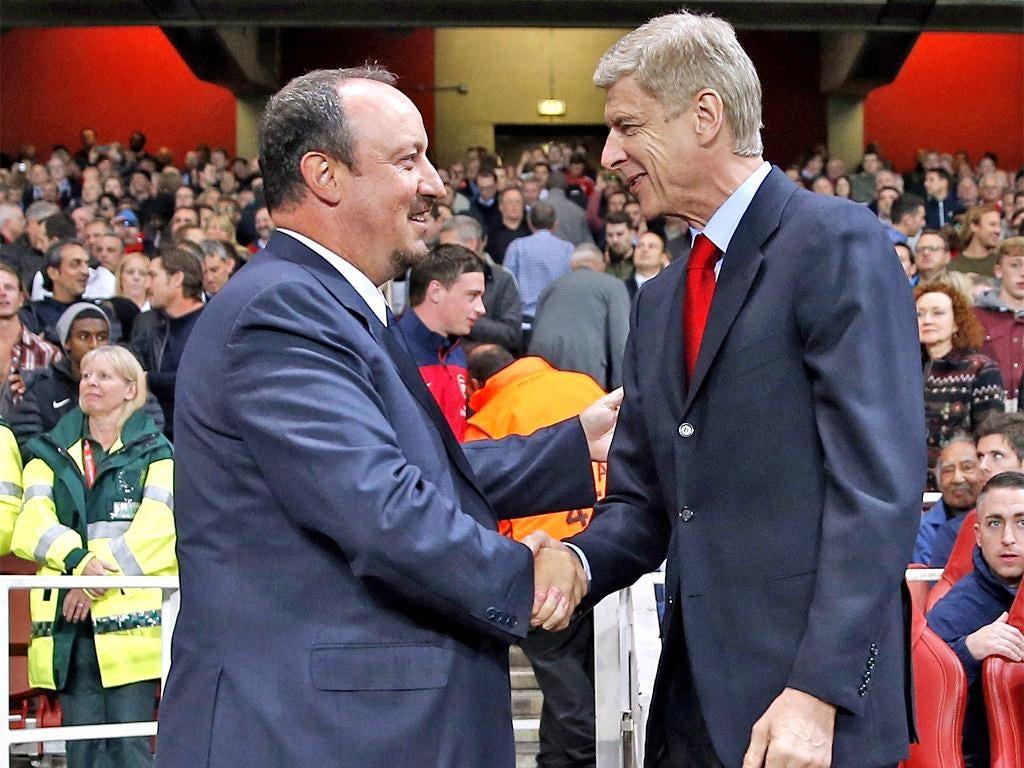 Rafael Benitez (left) shakes hands with Arsène Wenger