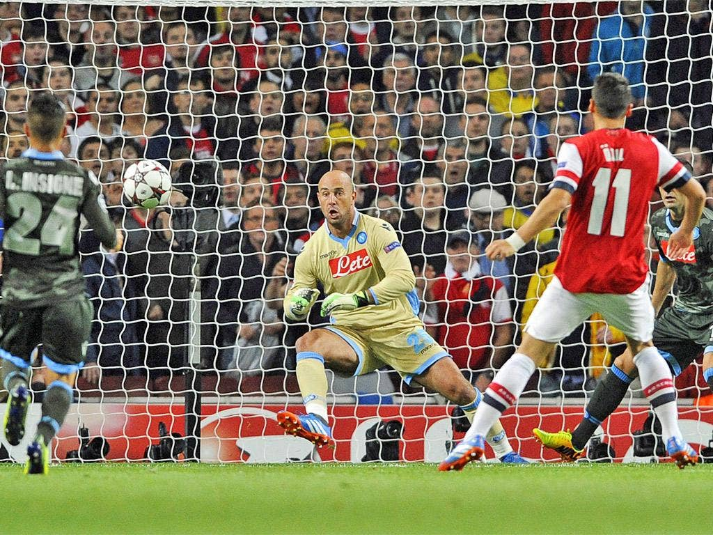 Özil places the ball beyond Pepe Reina's reach