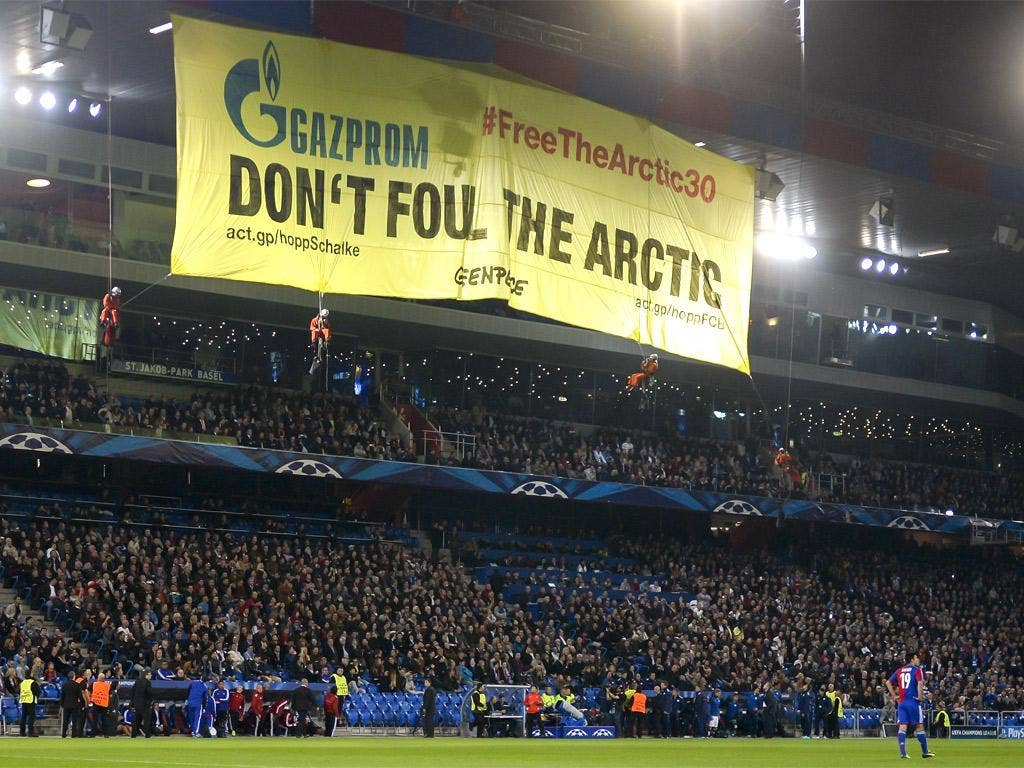 Greenpeace activists hold a demonstration during the Champions League match between Basel and Schalke