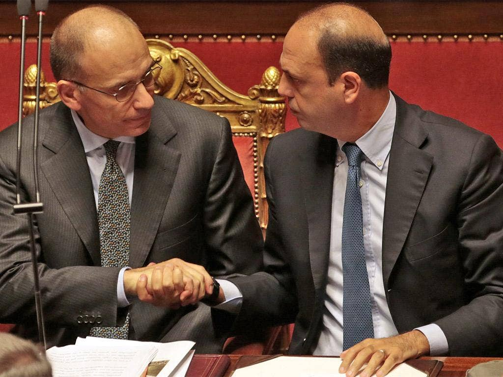 Prime Minister Enrico Letta (left) shakes hands with Interior Minister Angelino Alfano