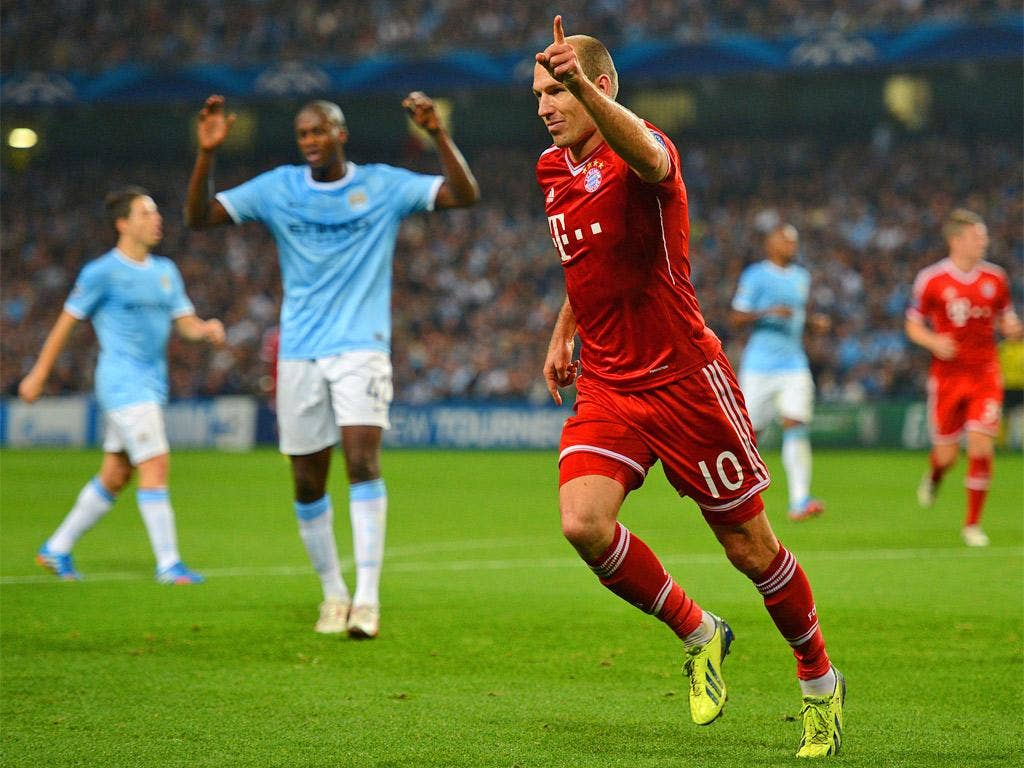 Arjen Robben celebrates Bayern Munich's third goal