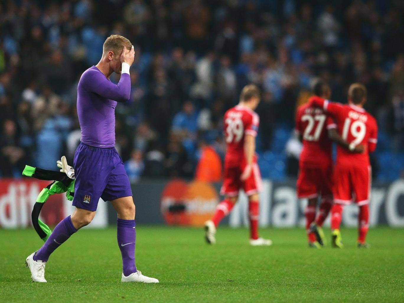 Joe Hart holds his head in his hands after the 3-1 defeat to Bayern Munich