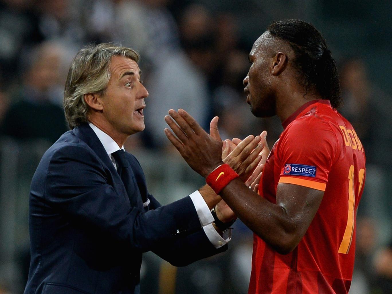 Roberto Mancini talks with Didier Drogba