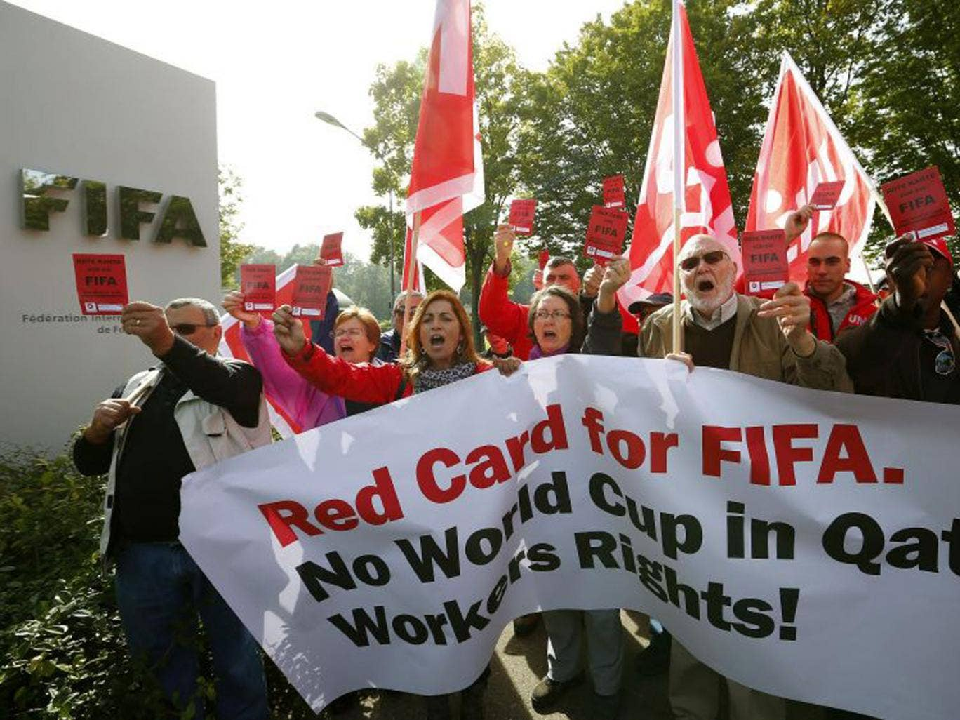 Members of Swiss workers' union Unia protest outside Fifa headquarters in Zurich