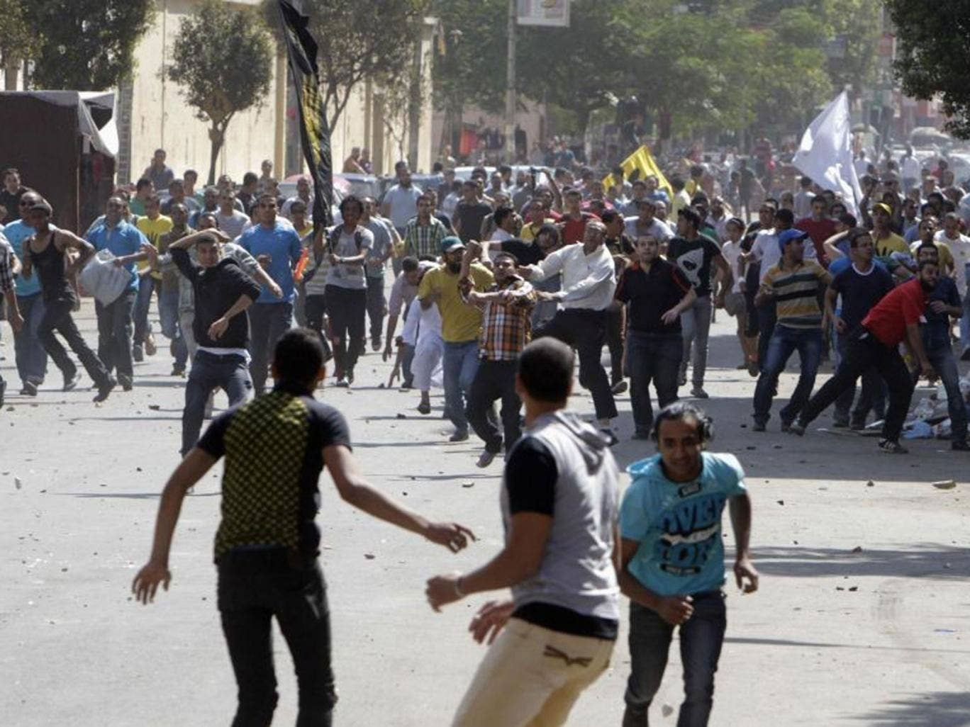 Supporters of deposed President Mohamed Morsi and the Muslim Brotherhood clash with anti-Morsi protesters during a march in Shubra street in Cairo