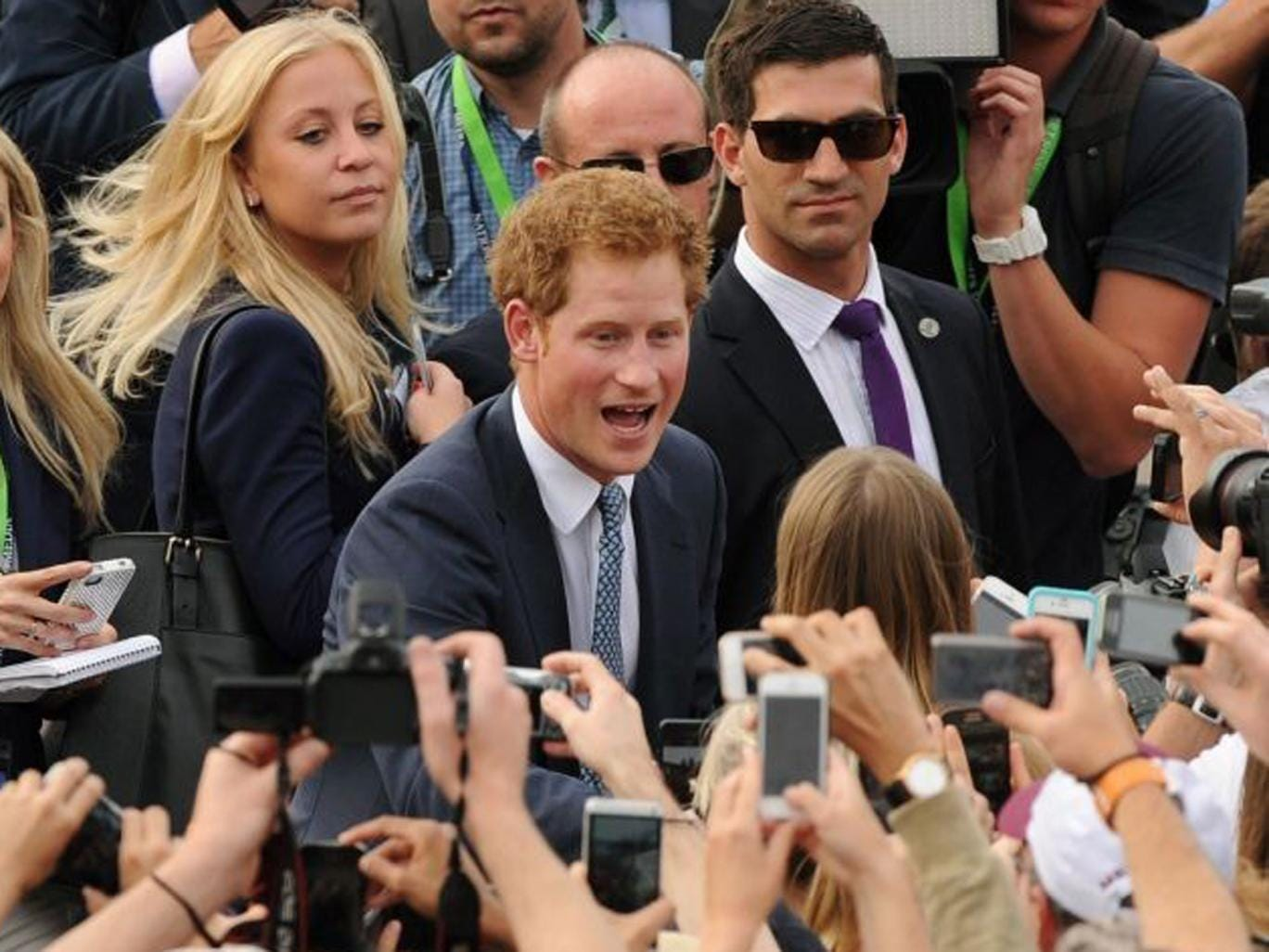 Prince Harry, who is in Sydney representing the Royal family at the International Fleet Review, meets members of the public during a walk about at Campbell's Cove in Sydney Harbour.