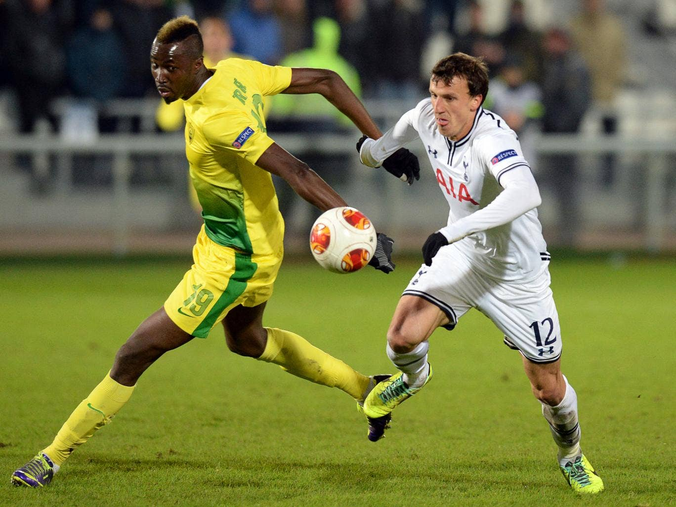 Vlad Chiriches of Tottenham dispossesses Lacina Traore of Anzhi Makhachkala