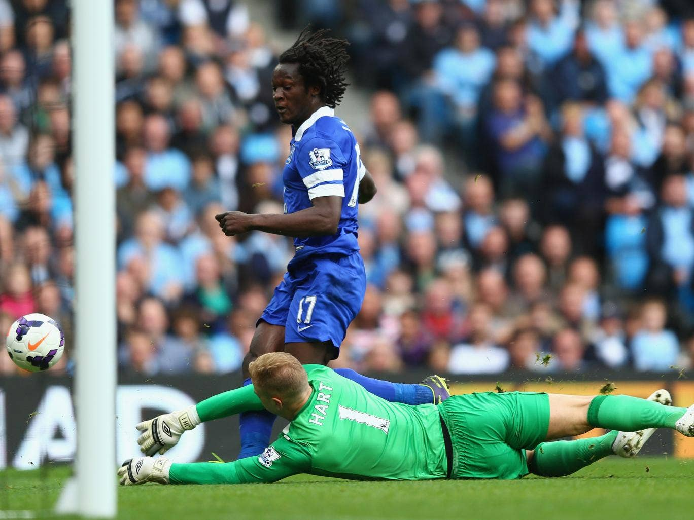 Joe Hart dives to try and save a shot from Romelu Lukaku