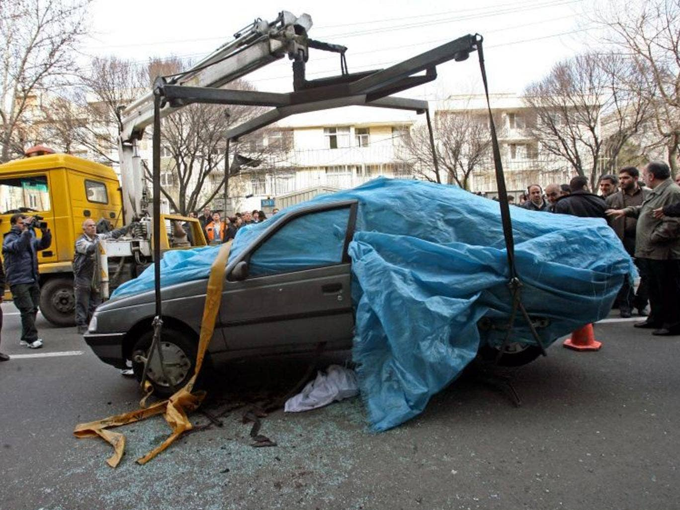Grim toll: The bombed car of Mostafa Ahmadi-Roshan, who was killed in January 2012 – one of five to die since 2007