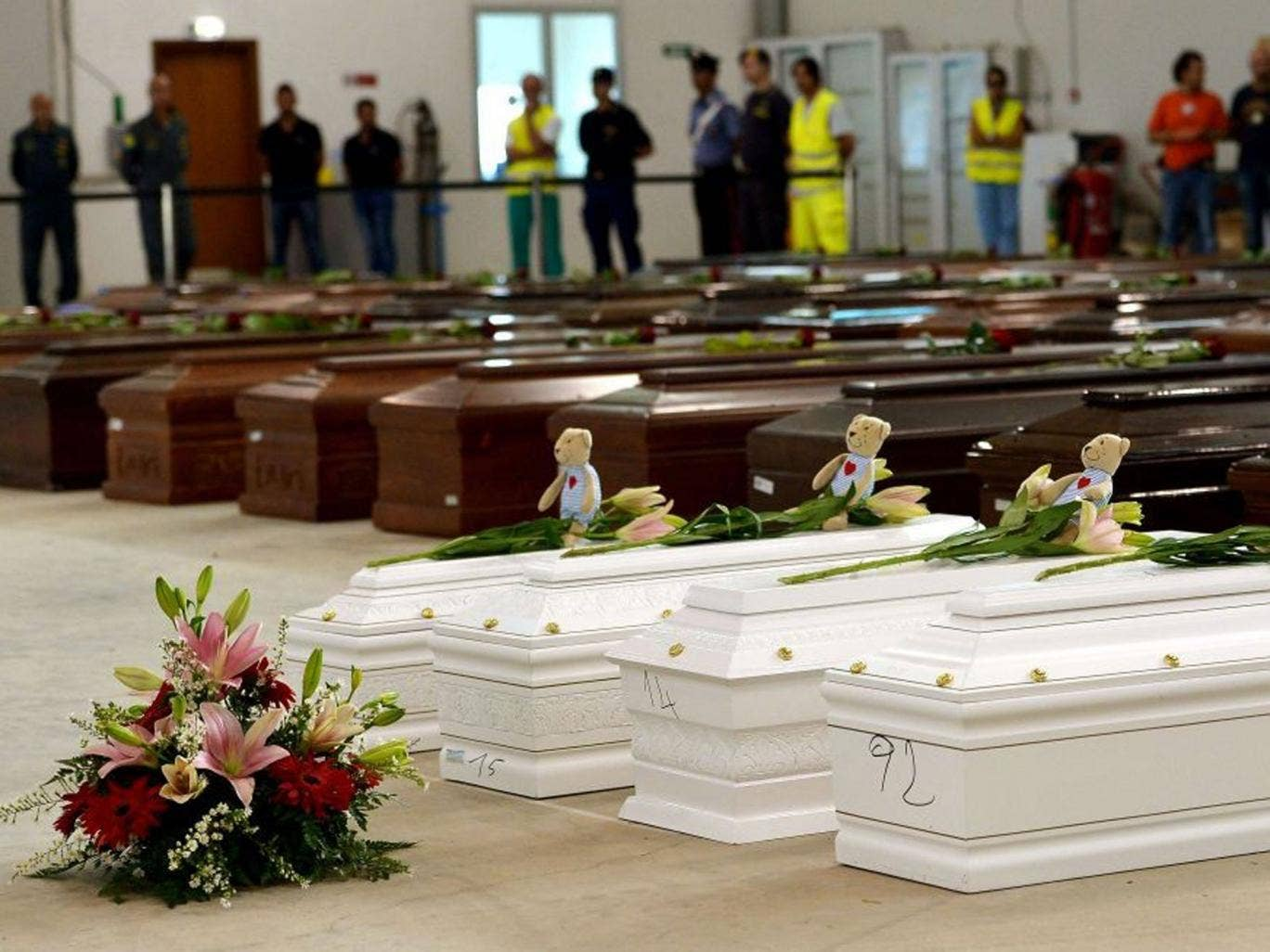 Coffins of children among the adult victims in an hangar of Lampedusa airport