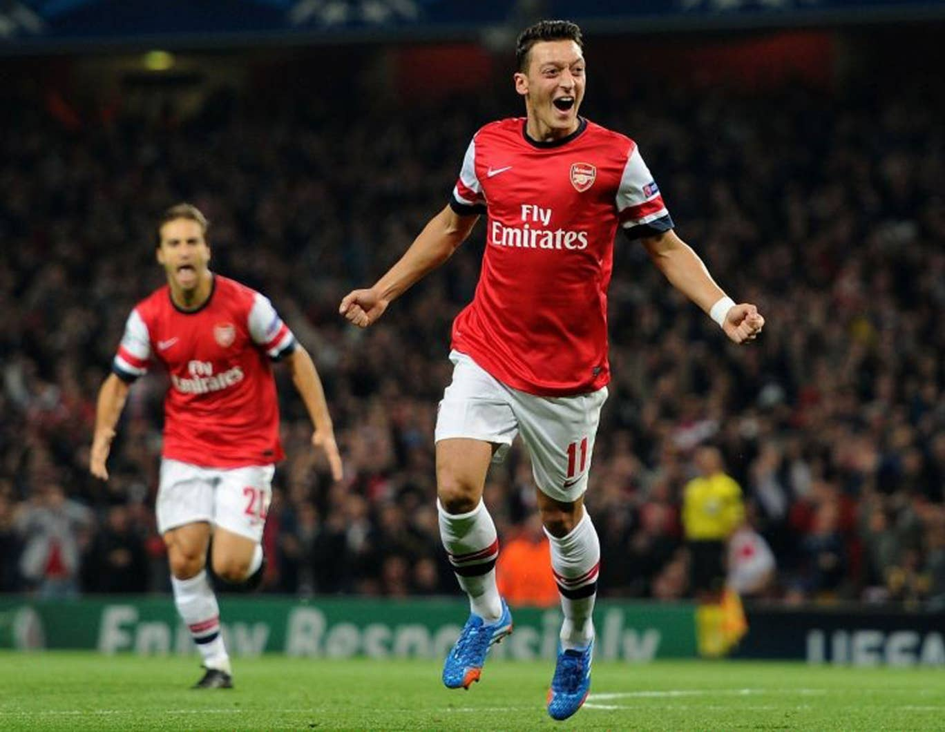 Great guns: Mesut Özil (pictured), Olivier Giroud and Aaron Ramsey have been instrumental in Arsenal's start