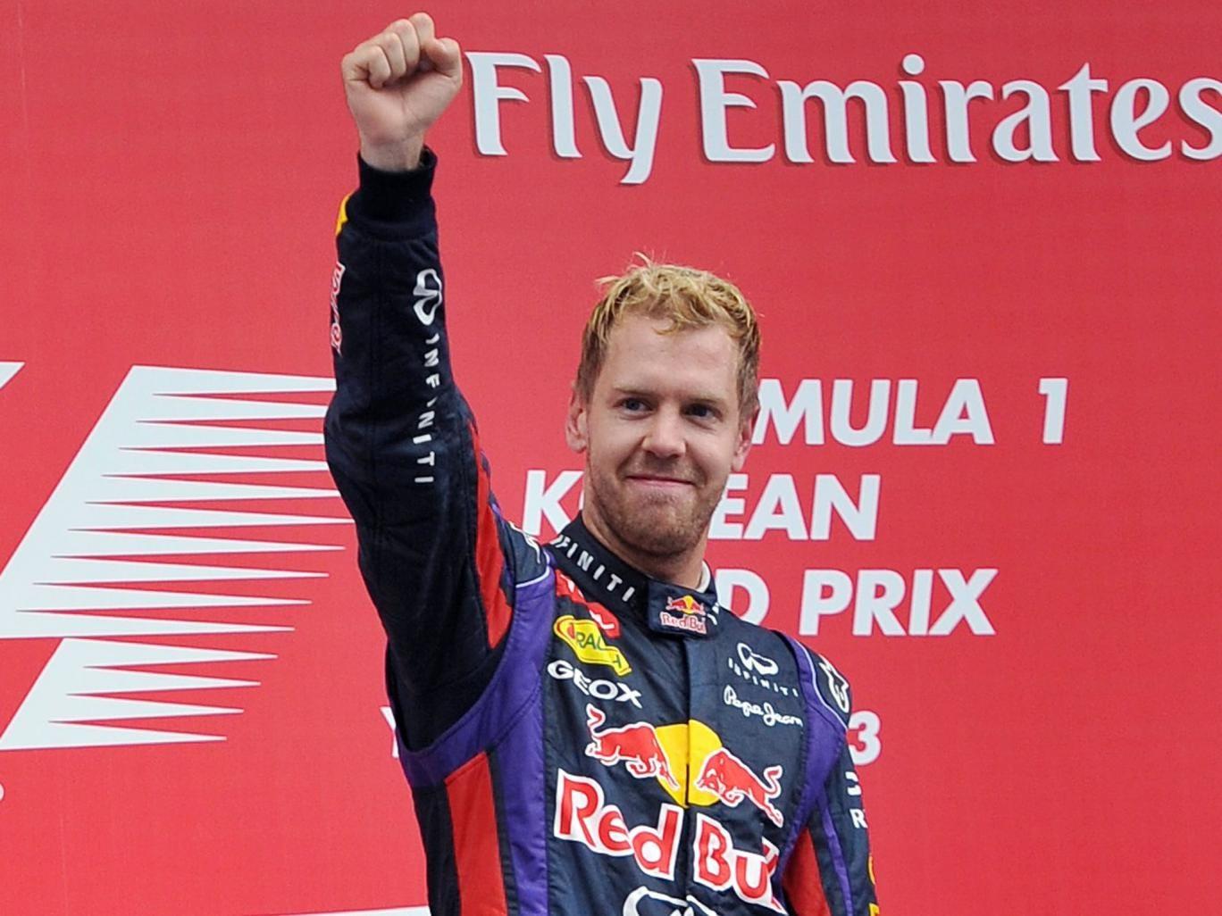 Sebastian Vettel celebrates on the podium in Korea