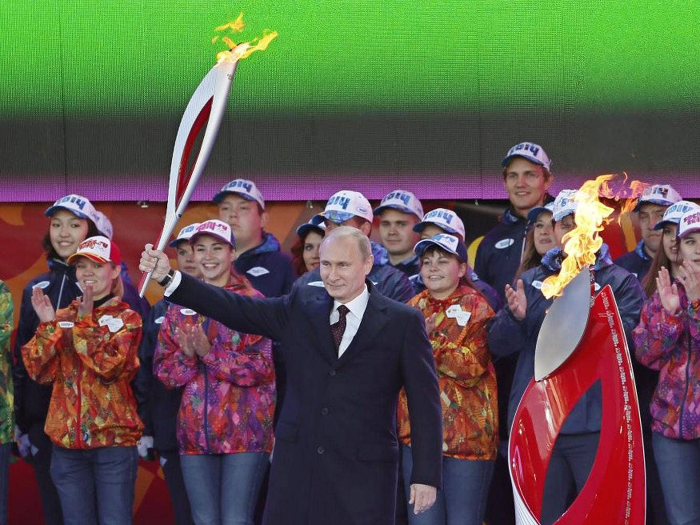 Vladimir Putin with the Olympic torch at a ceremony in Moscow yesterday