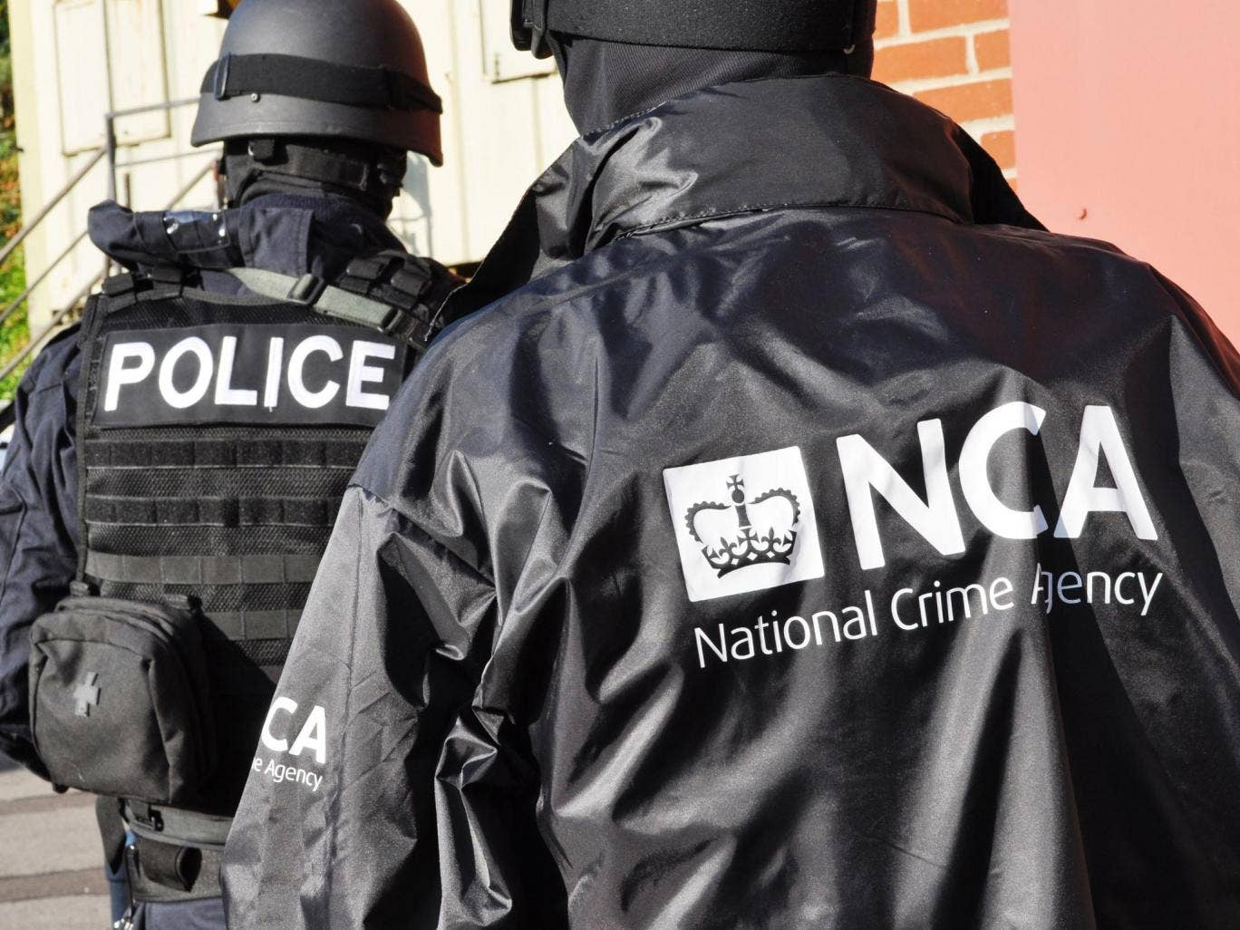 """7 October 2013: A shot of officers in the newly formed National Crime Agency during a training exercise. The head of """"Britain's FBI"""" has warned the 'Mr Bigs' of the underworld there will be """"no one beyond the reach"""" of the new crime-fighting agency on the"""