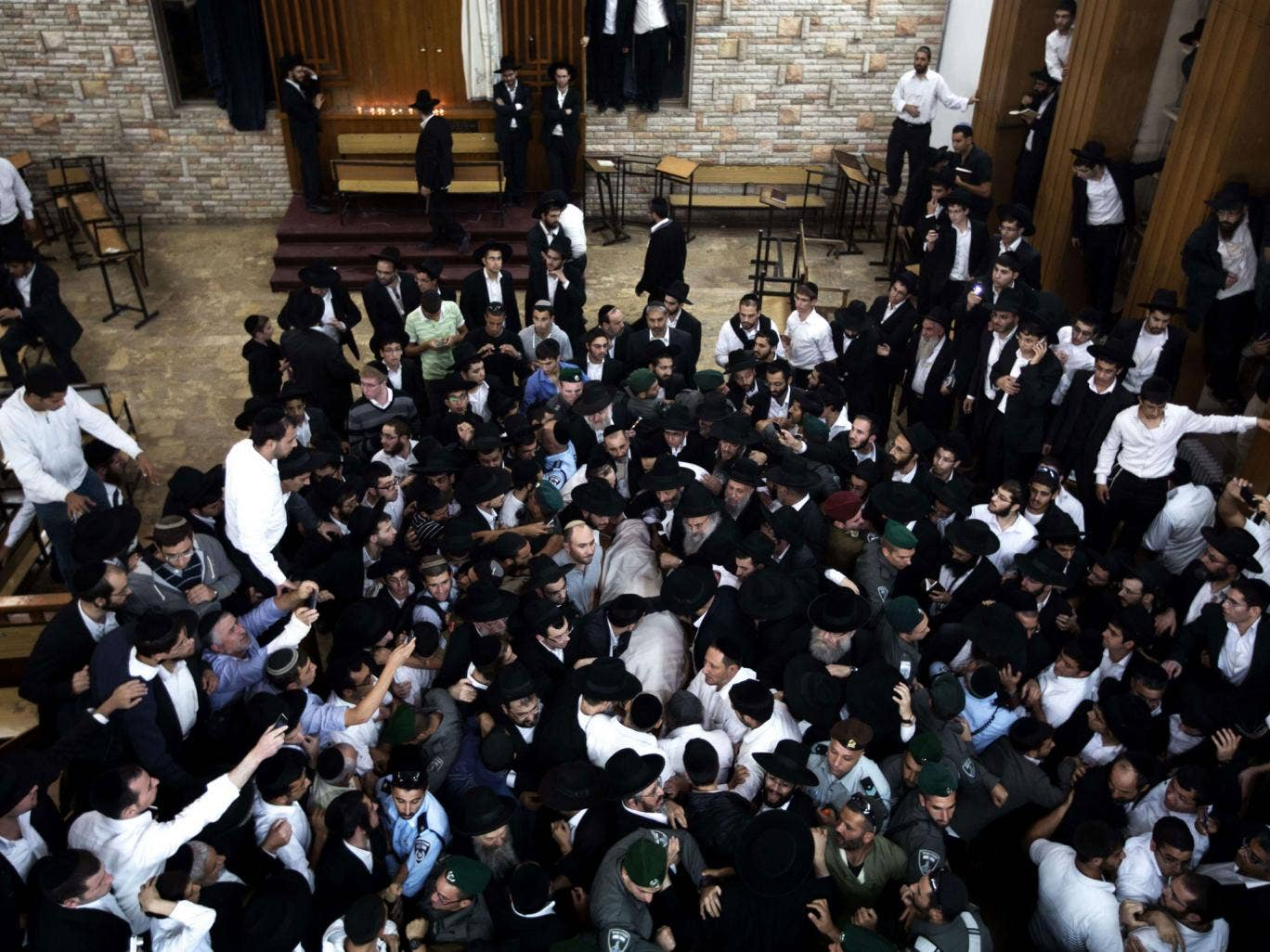 Ultra-orthodox Jewish mourners carry the body of Rabbi Ovadia Yosef during his funeral in Jerusalem`