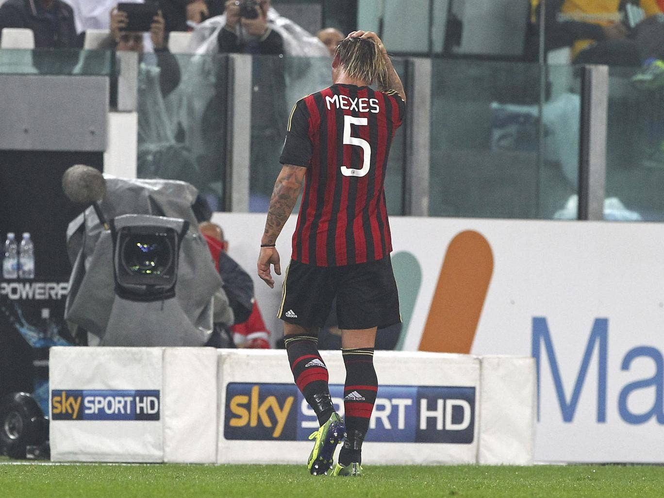 Philippe Mexes walks after bring shown a red card