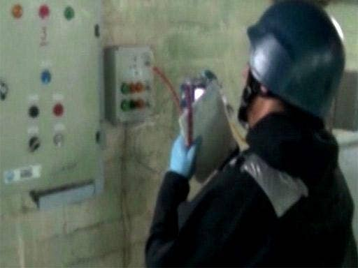 An OPCW inspector at work in Syria on Tuesday