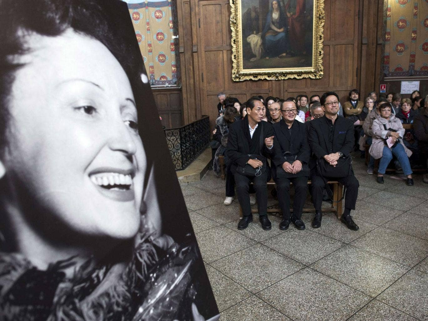 The congregation at the service for Edith Piaf, the French singer, whose song 'La Vie en Rose' has inspired many books and films