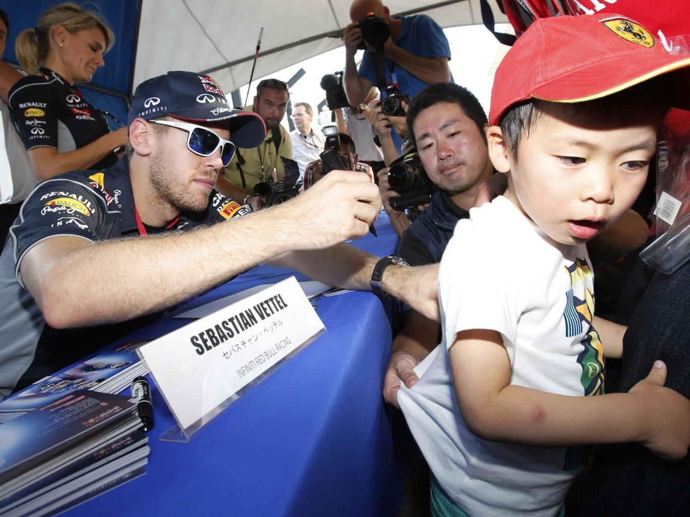 Sebastian Vettel signs autographs for fans at Suzuka