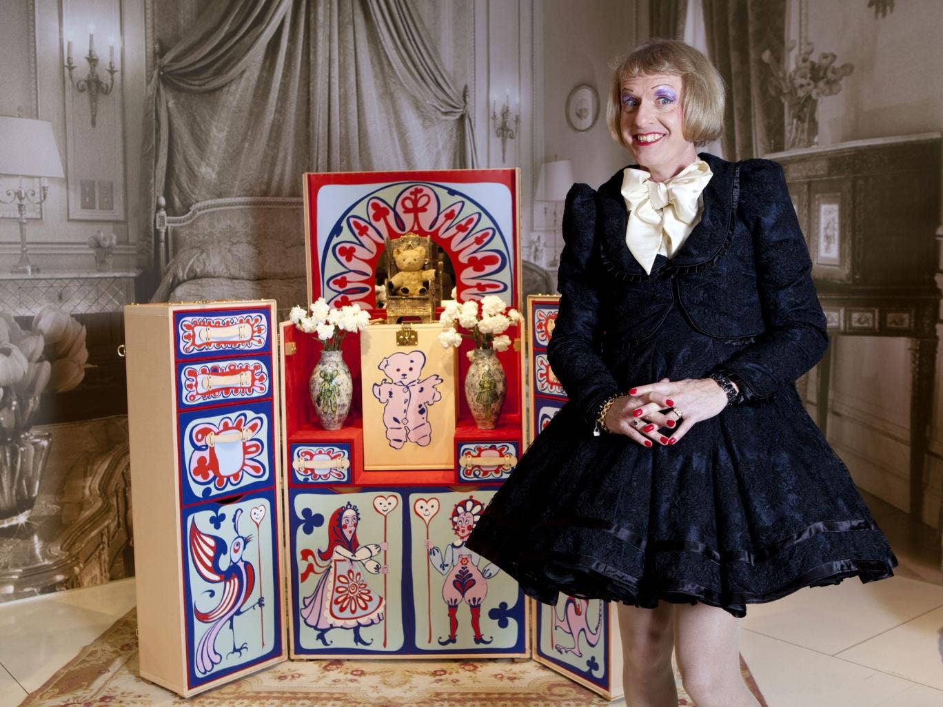 Grayson Perry with the Louis Vuitton trunk he designed, including a replica of his childhood teddy bear Elton