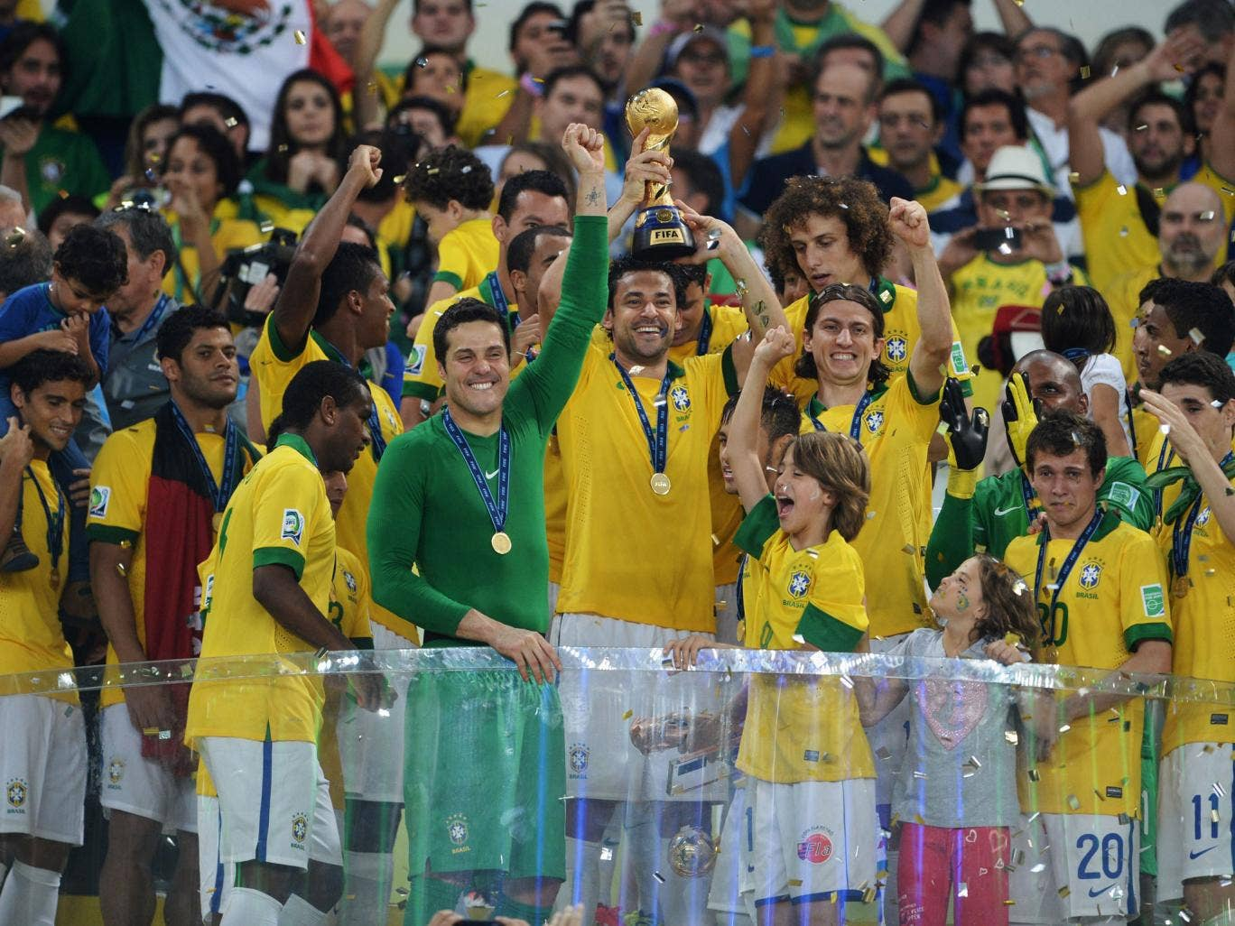 Fred lifts the Confederations Cup for Brazil after their final victory over Spain in Rio in June