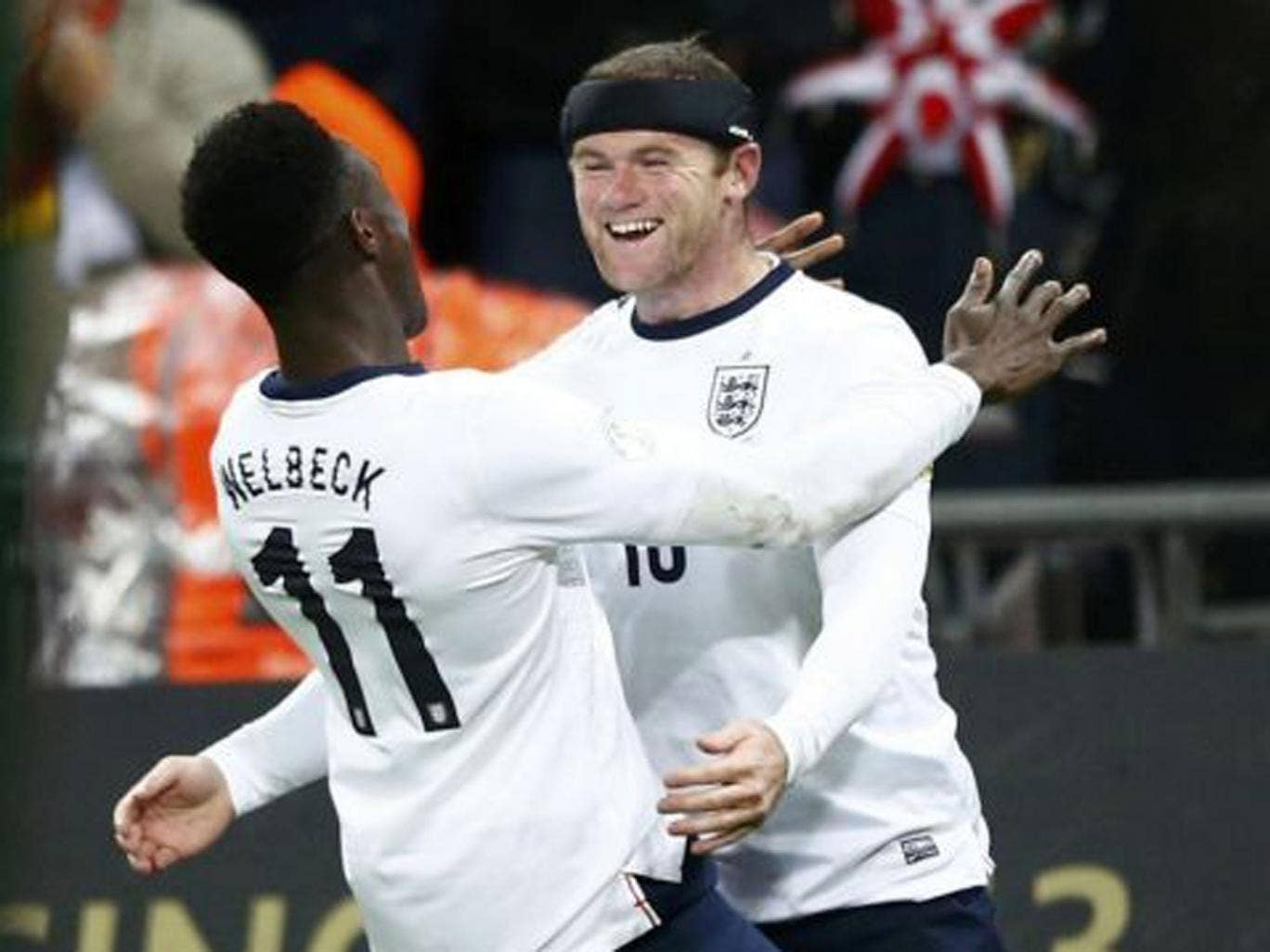 Opening salvo: Wayne Rooney celebrates with Danny Welbeck after he scored England's first goal against Montenegro on Friday night reuters