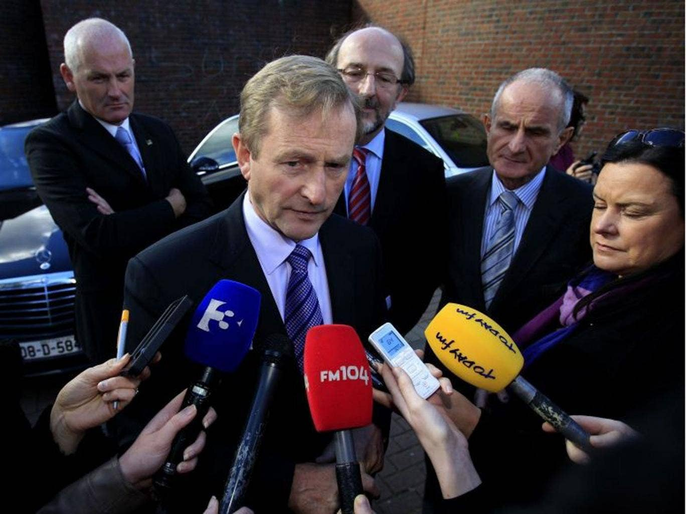 Taoiseach Enda Kenny speaks to members of the media. He has confirmed that Ireland will exit its strict bailout programme by the end of the year