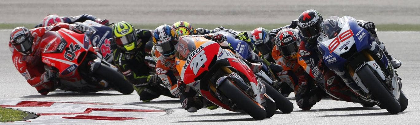 Dani Pedrosa (26) leads the pack on his way to victory at the Malaysian Moto GP in Sepang