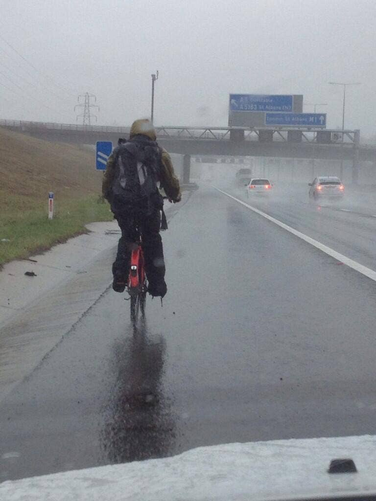 A picture tweeted by police of an unnamed man riding his bike up the hard shoulder on the M1