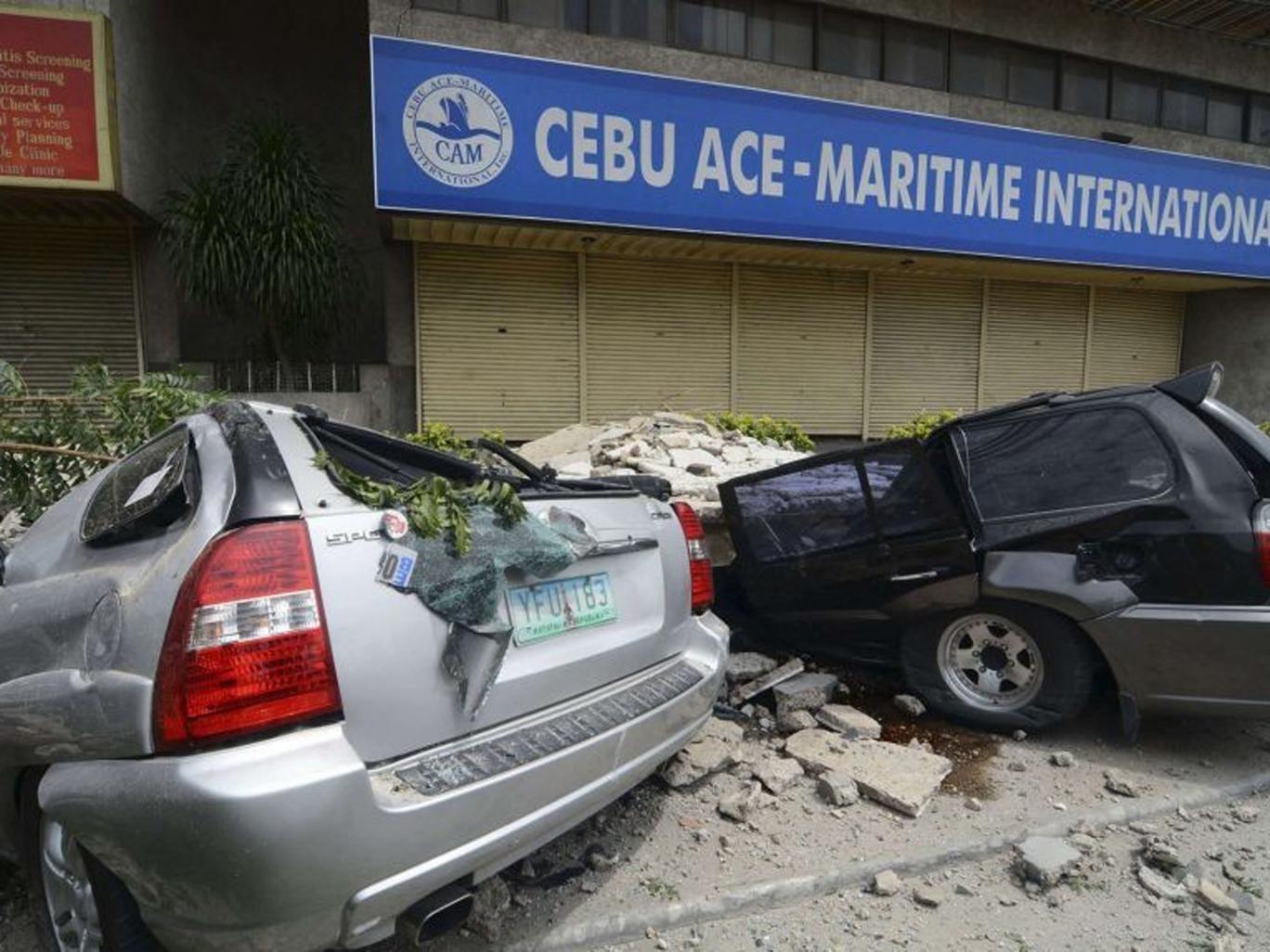 Vehicles damaged by falling debris after an earthquake struck Cebu city