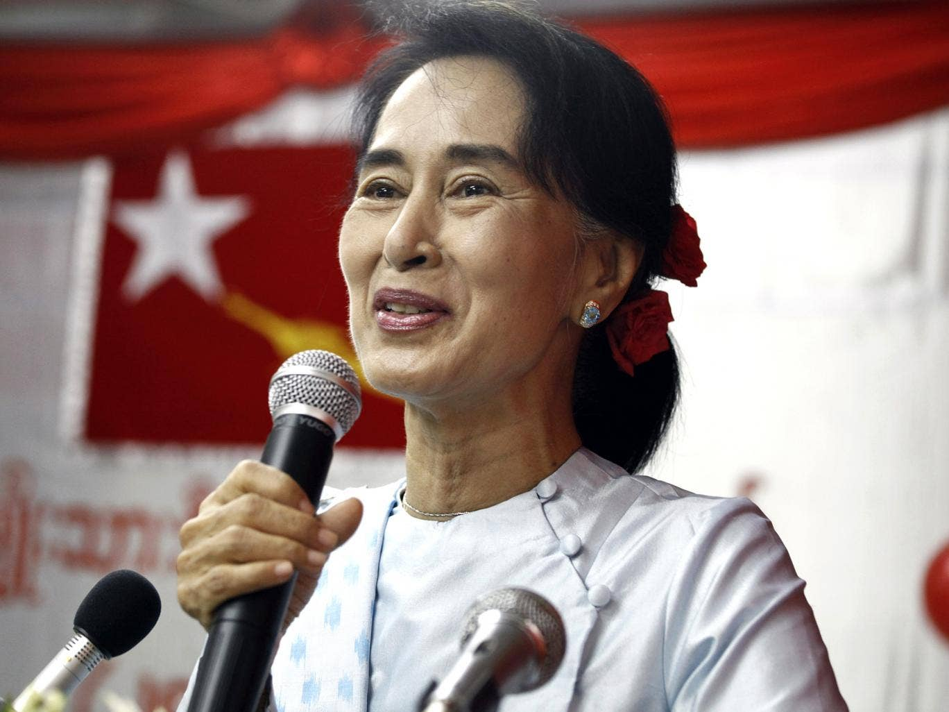 Aung San Suu Kyi delivers a speech at the National League for Democracy (NLD) headquarters in Yangon, last month
