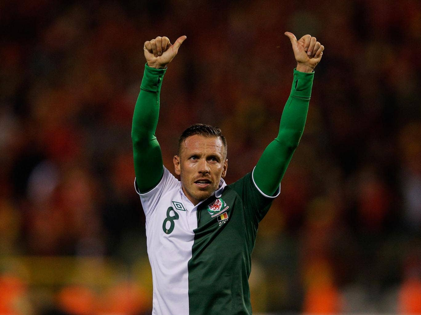 Craig Bellamy waves goodbye to the Wales fans as he retires from international football after their 1-1 draw with Belgium
