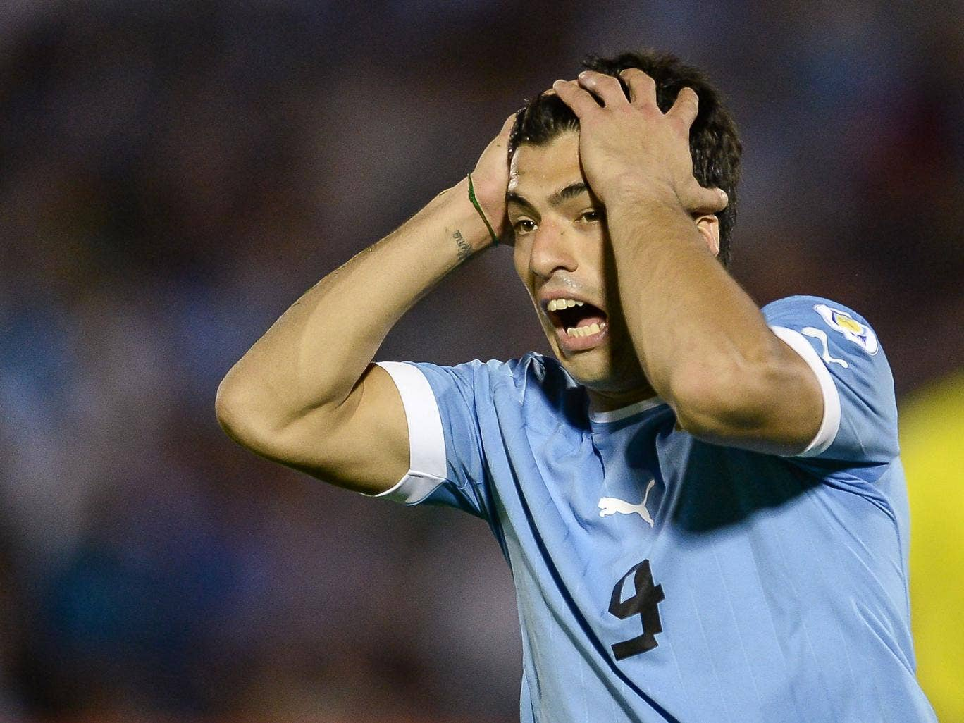 Luis Suarez reacts during Uruguay's 3-2 victory over Argentina