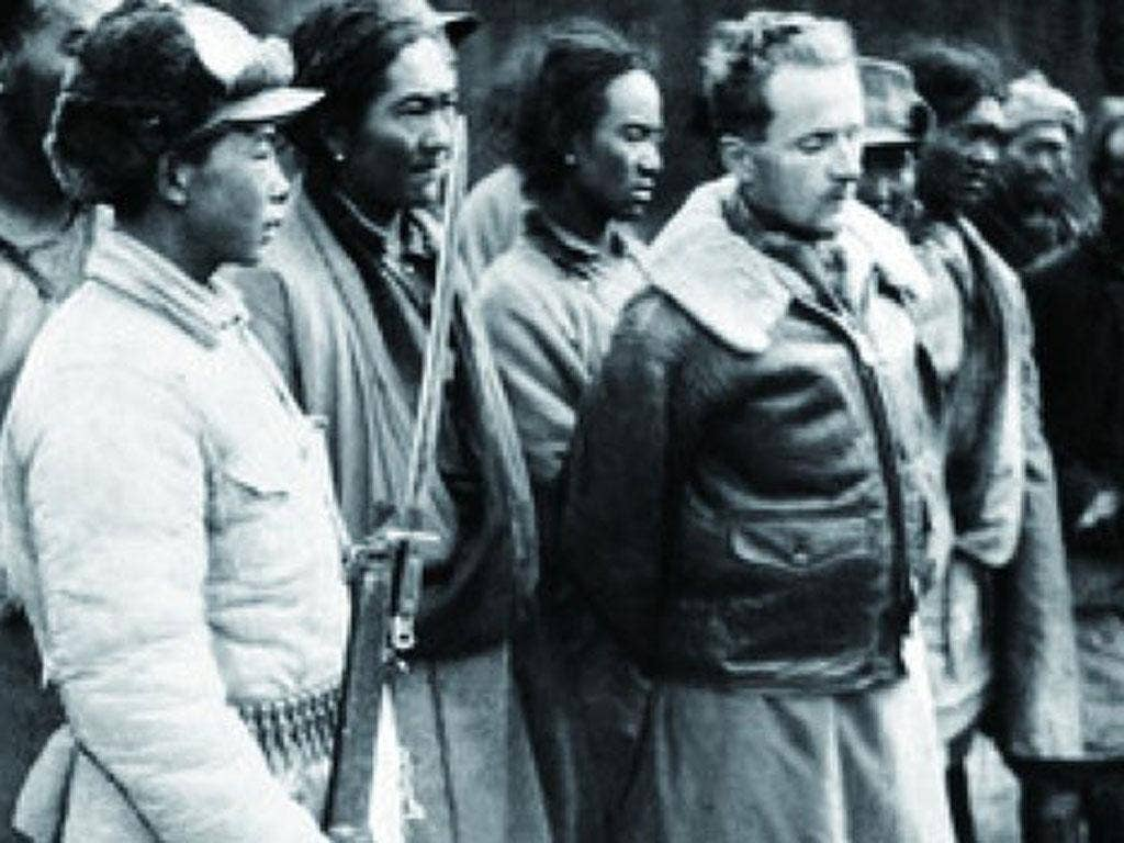 Ford is paraded by Chinese troops after being arrested in 1950