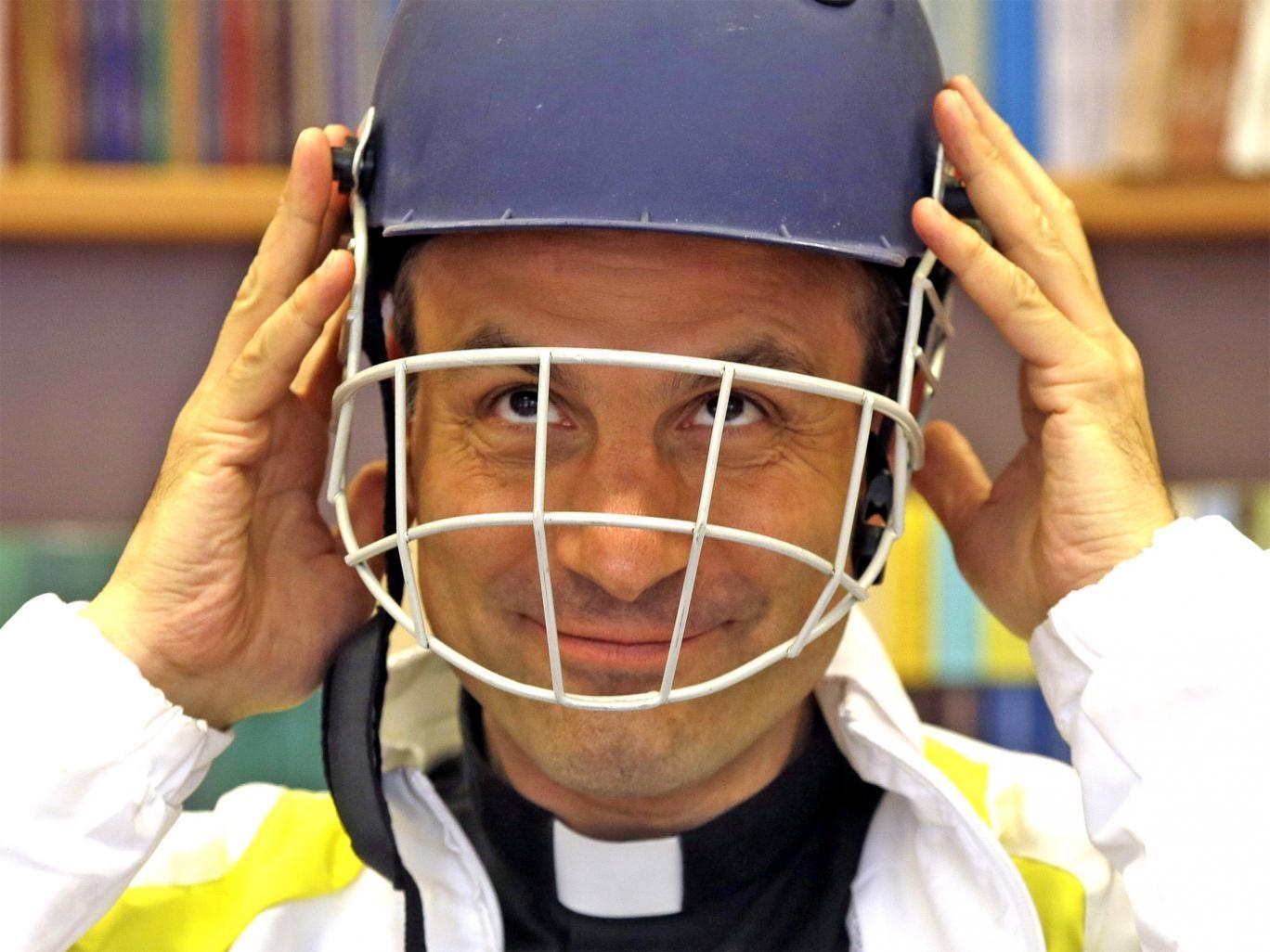 Monsignor Sanchez de Toca y Alameda, undersecretary of the Pontifical Council for Culture, wears a cricket helmet during the presentation of the Vatican cricket club at the Vatican