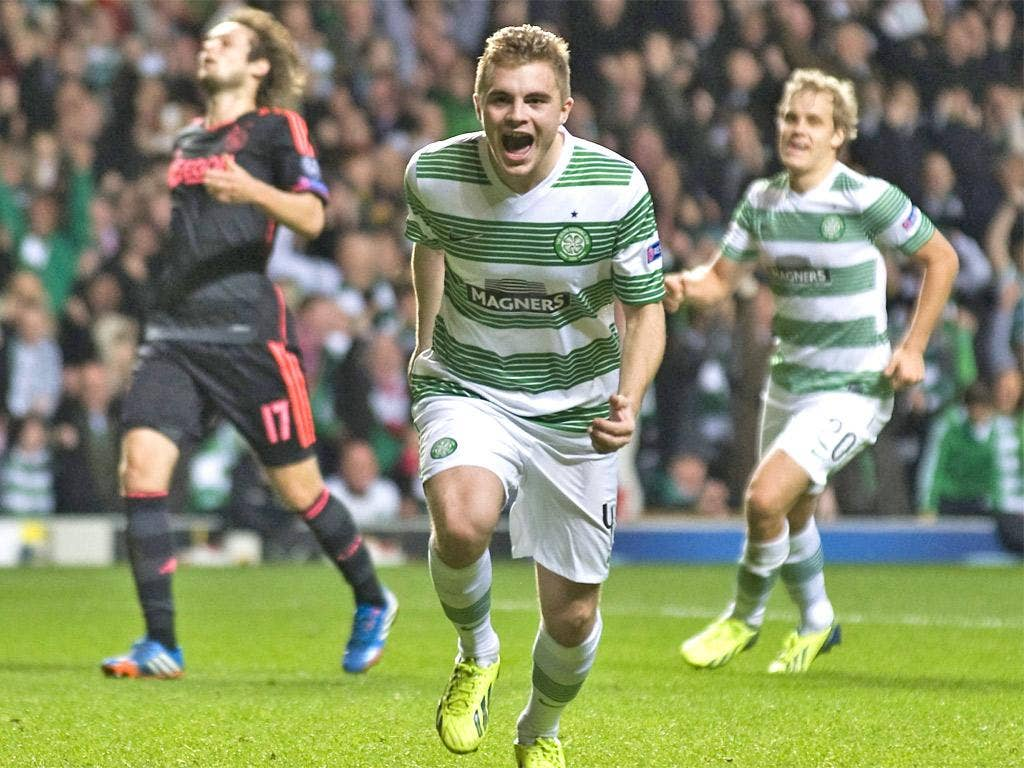 James Forrest celebrates as his penalty gives Celtic the lead