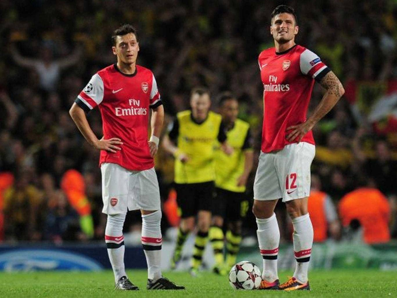 Mesut Özil (right) feels the pain of defeat on Tuesday