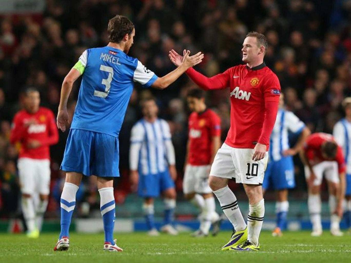 Wayne Rooney of Manchester United shakes hands with Mikel Gonzalez of Real Sociedad at the end of the UEFA Champions League Group A match