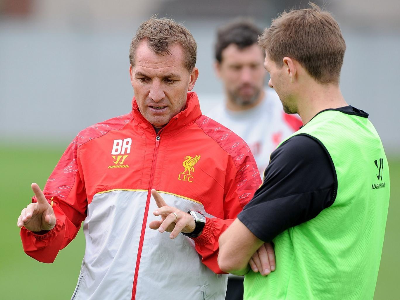 Brendan Rodgers (left) and Steven Gerrard talk tactics during Liverpool training