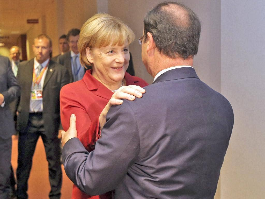 Angela Merkel greets François Hollande before a bilateral meeting on the sidelines of the summit