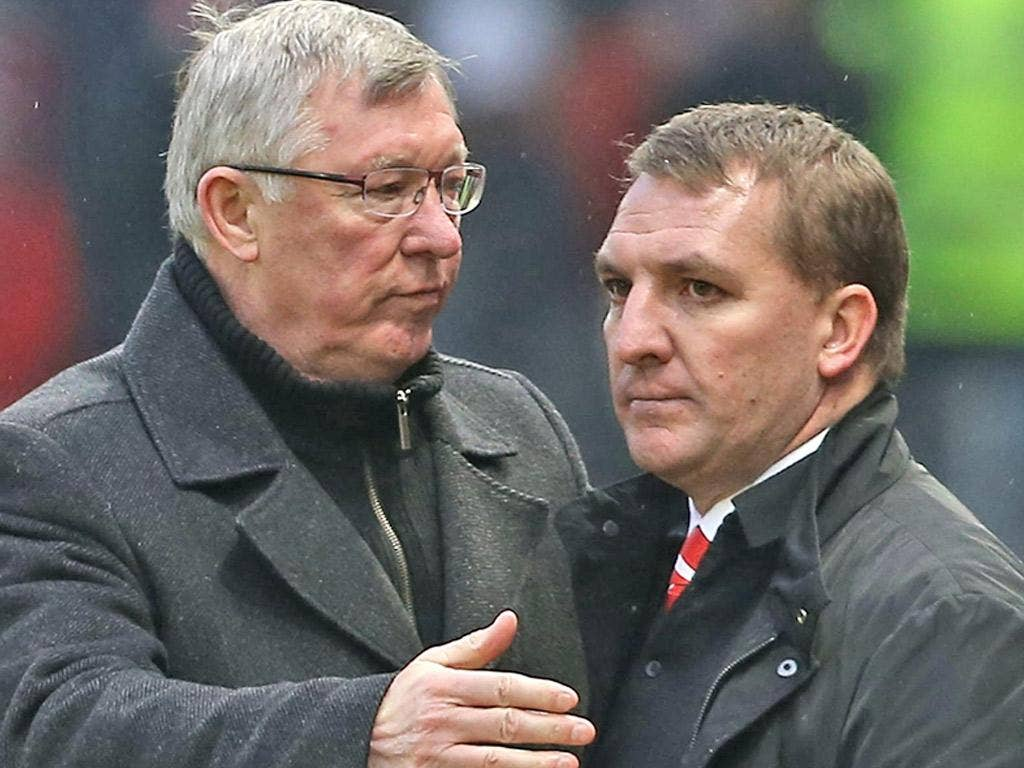 Ferguson and Rodgers on the touchline during an encounter between Manchester United and Liverpool last season