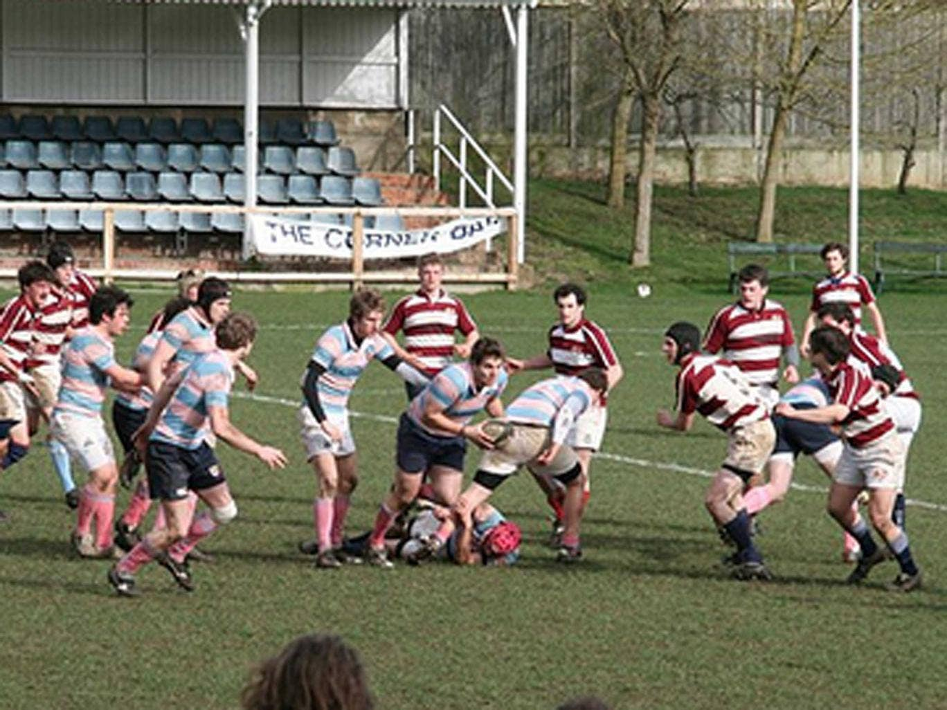 A historic image of Pembroke College's rugby player's in action, from Rugby Football Club's homepage