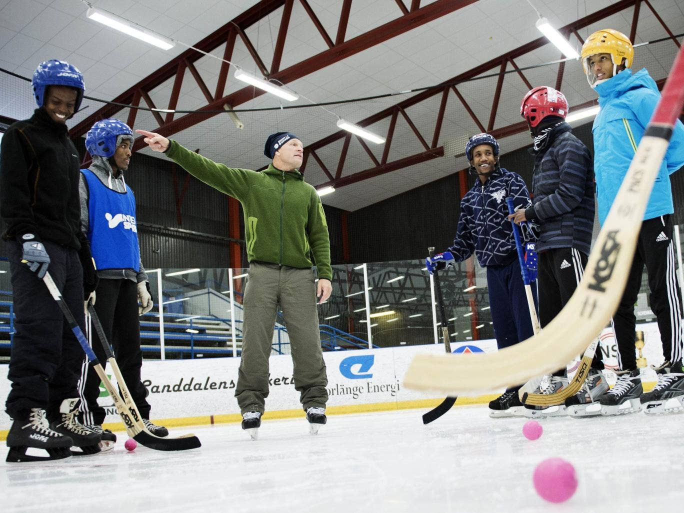 The Somali ice-bandy team practising with coach Per Fosshaug in Sweden