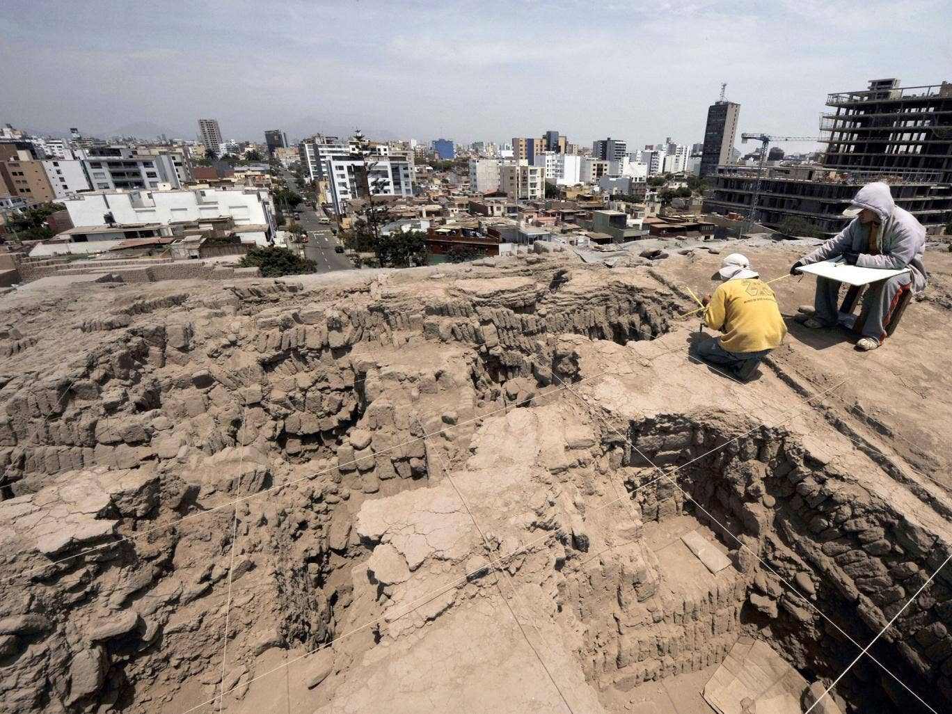 Archaeologists work at the pre-Inca religious complex 'Huaca Pucllana'