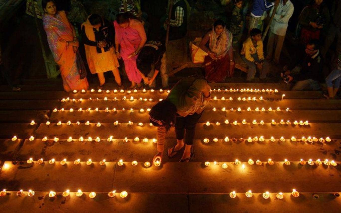 Hindus mark the festival of lights but the country is held back by slowing growth and deficits